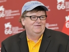 Michael Moore says he's in the ICU for pneumonia