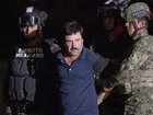 Drug lord Guzman's lawyers split on extradition