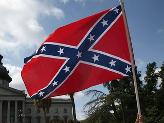 Cop suspended for driving with Confederate flag