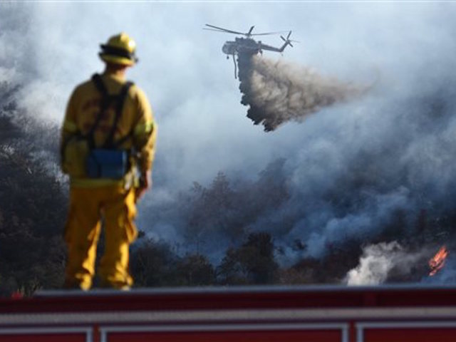 Portion of major highway reopens as California wildfire rages