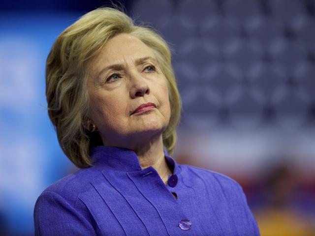Clinton Announces Plans to Halt Campaign for 9/11
