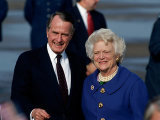 President Bush remains in ICU while improving