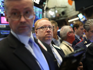 Dow tumbles, recovers quickly