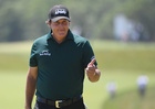 Mickelson taps still-moving ball during US Open
